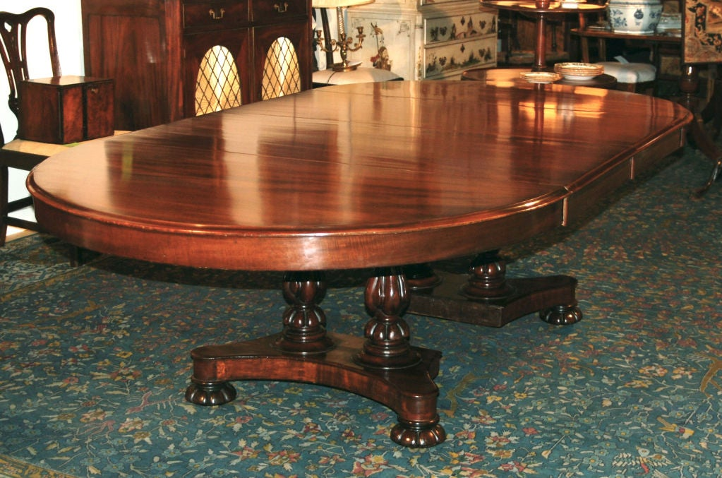 An English Mahogany Extending Dining Table By Samuel