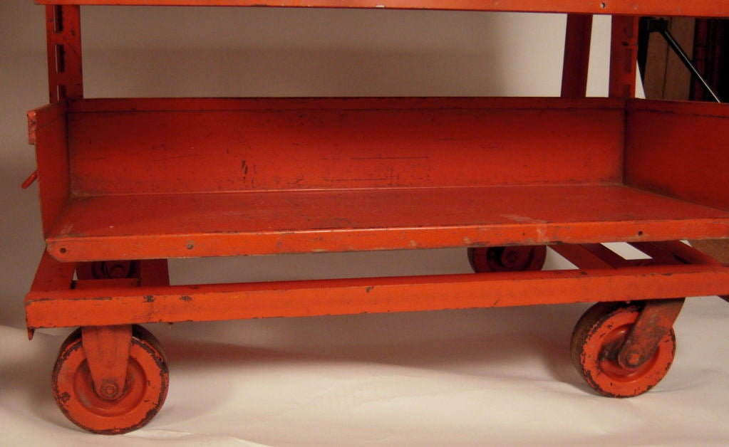 American PAIR OF ORANGE METAL INDUSTRIAL  ADJUSTABLE STORAGE SHELVES For Sale