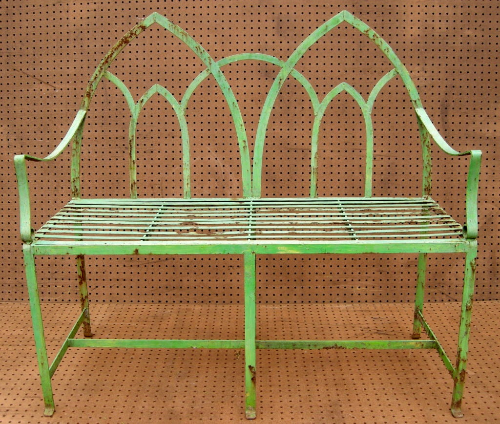 Vivid apple green gothic garden settee.  Elegantly simple yet with bold and flowing lines.  An inviting exterior or interior standout.