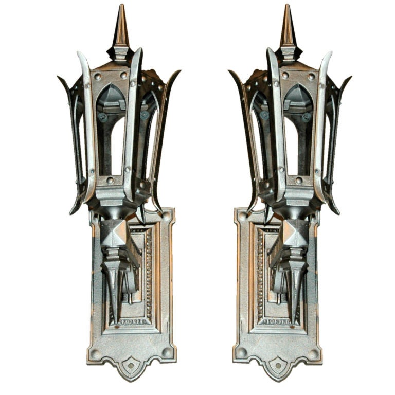 Fantastic Pair of Hand Polished Cast Iron Sconces For Sale