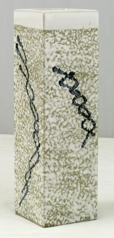 Square columnar pottery vase in a heathered white glazed finish with a black intertwined line design. Signed