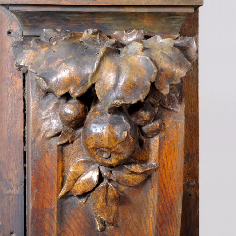 Early 19th century carved wood wall plaques or corbels. These are extra-large 6 foot panels with carved leaves and fruit on the top and swags of flowers on the bottom. Two matched pairs with a right and left facing piece for each pair. A set of four
