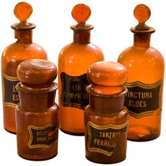 Selection of antique handblown glass apothecary bottles