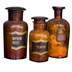 set three antique bottles