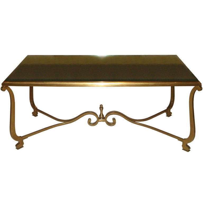 Scrolled bronze coffee table with antique mirrored top at 1stdibs Bronze coffee tables