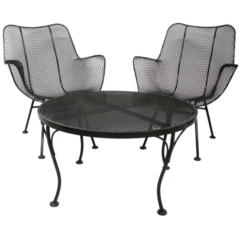 Wrought iron and mesh table with four armchairs by woodard for Mesh patio chairs