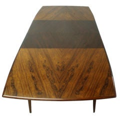 A Large  Boat Shaped Rosewood Dining Table