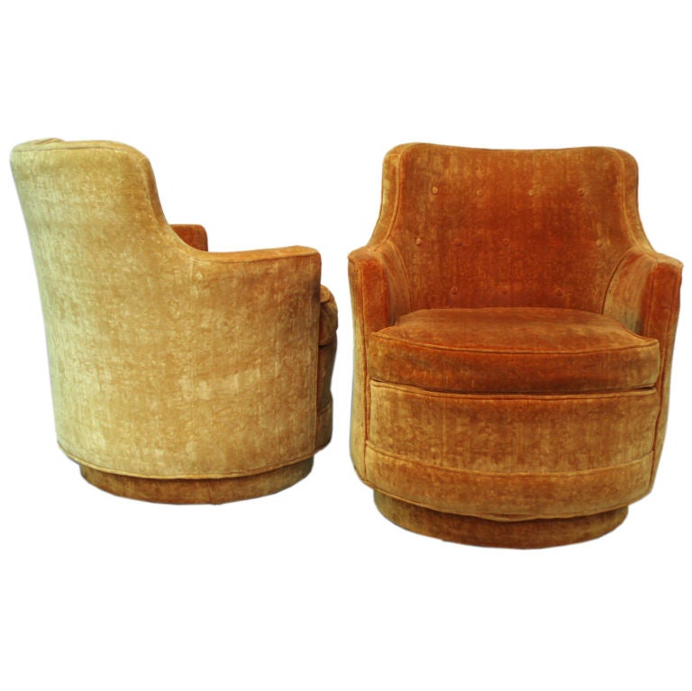 A Pair Of Swivel Tub Chairs In The Style Of Edward Wormley