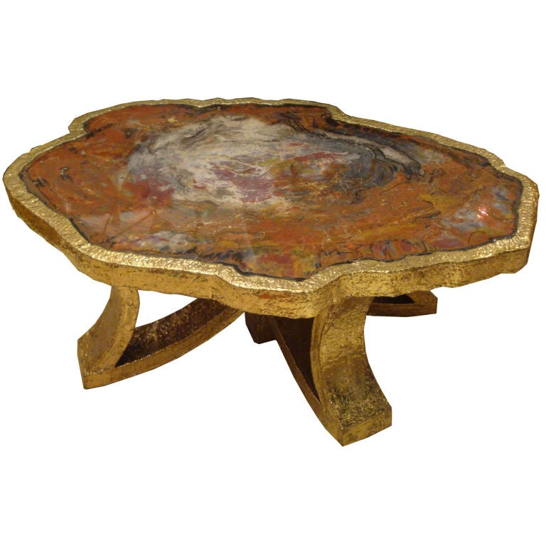 A Cocktail Table In Petrified Wood And Hammered Gilt Bronze At 1stdibs