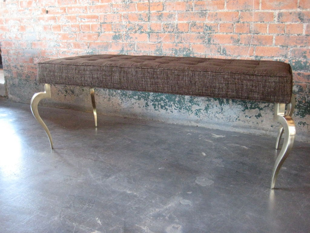 Extremely well made bench with metal frame and solid brass legs with beautiful patina. Reduced from $1600.