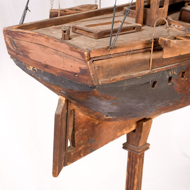 A sailer made folky ship model that has the hull of a whaler.