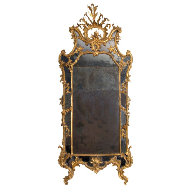 A carved and gilded rococo mirror with antique mirror for Gilded baroque mirror