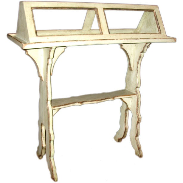 A painted reading stand with mecca silvered trim lyre
