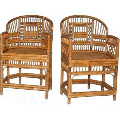 A pair of Brighton Pavillion style bamboo armchairs