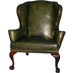 George II period walnut leather upholstered wingback armchair