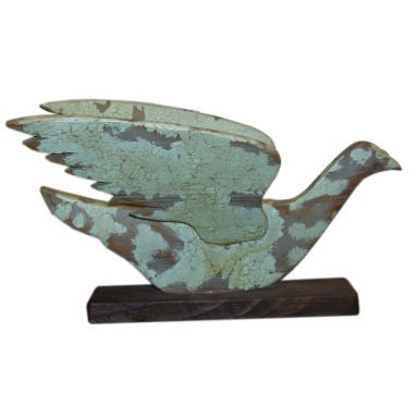 Handcarved Bird with a Crackle Finish, signed.