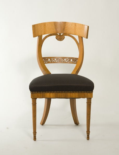 Sculptural suite of Biedermeier sidechairs with intricate carved detailing. Upholstered in black fabric.<br />