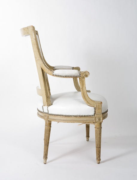 French Louis XVI style armchair upholstered in white leather.<br /> From the estate of Geraldine Stutz.