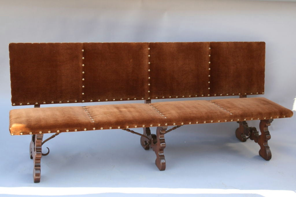 Long upholstered spanish bench w iron stretchers at 1stdibs Long upholstered bench
