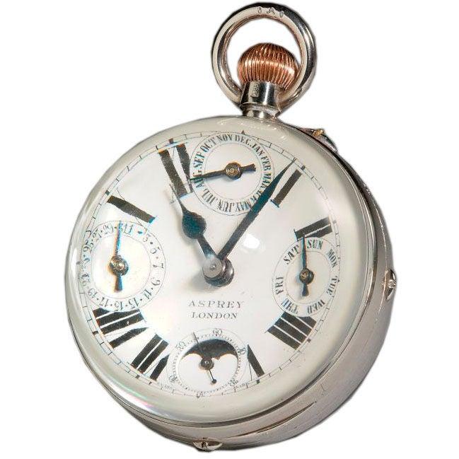 Asprey & Co: 'Ball' clock / Paperweight.