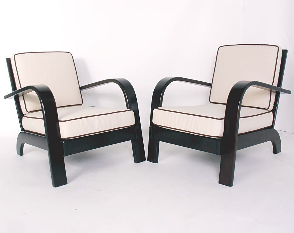 Pair of Streamlined Lounge Chairs, designed by Russel Wright for Conant Ball, circa 1940s.