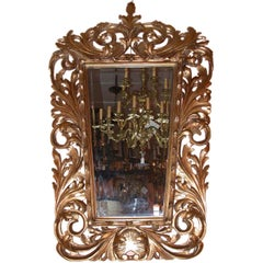 Italian giltwood  Baroque mirror in boldly carved frame