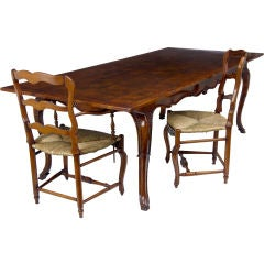 Pippy oak & fruitwood carved leg table and 8 Chairs to match