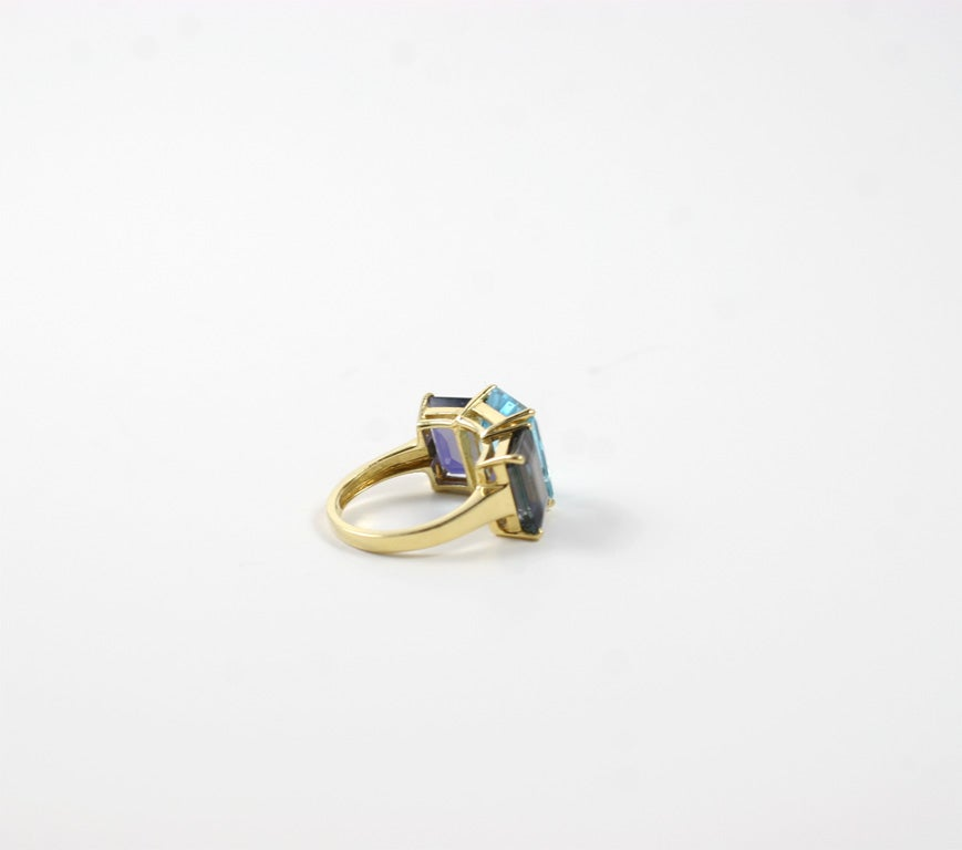 18kt yellow gold emerald cut ring with blue topaz and