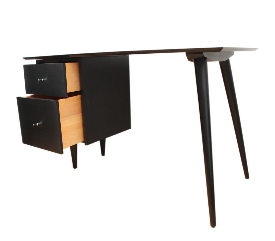 Signature style Paul McCobb 2 drawer Planner Group desk, restored to perfection in a black lacquer piano finish. Solid maple construction throughout, with solid brass conical drawer pulls. Lower drawer is perfect for files with upper drawer