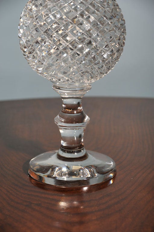 A striking  crystal ball on pedestal-a perfect accent piece!