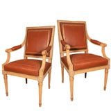 Pair of 1940's Brown Leather Bergeres with Ceruzed Finish