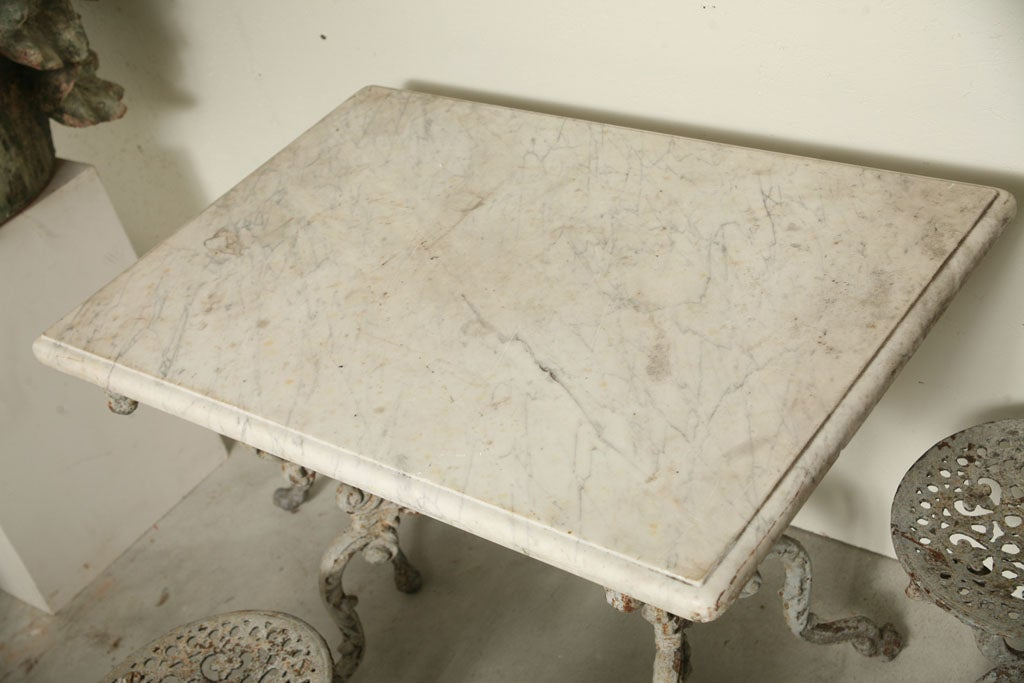 Suite of Grey Painted Cast Iron Table and Four Tabourets For Sale 1