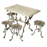 Suite of Grey Painted Cast Iron Table and Four Tabourets