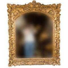 Elaborately Carved Gilt Mirror
