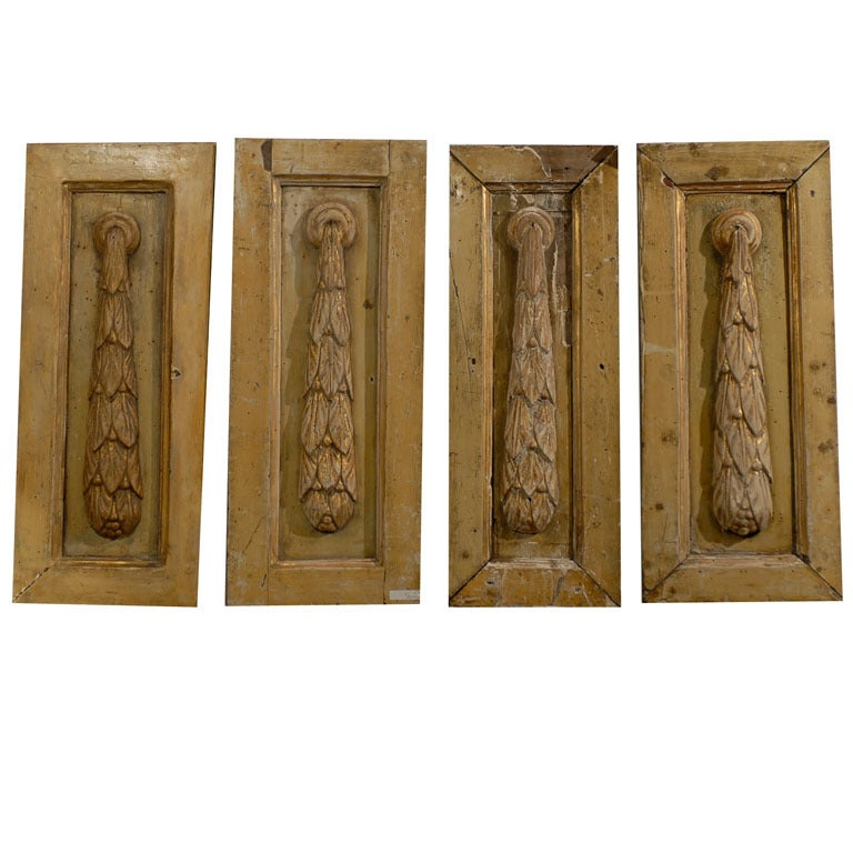 Set of four carved panels at stdibs