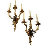 Pair of Patinated Bronze 3-Candle Sconces with Figural Putti