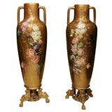 Pair of Tall Aesthetic Period Bronze Mounted Faience Vases