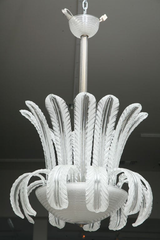 Dramatic white and colorless Murano glass chandelier with scrolling leaf motif. Beautiful from every angle- this chandelier is a classic.