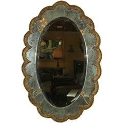 Pair of Venetian oval mirrors