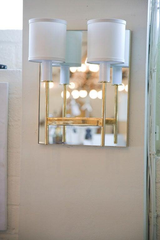 American Paul Marra Brass Mirror Back Sconce For Sale