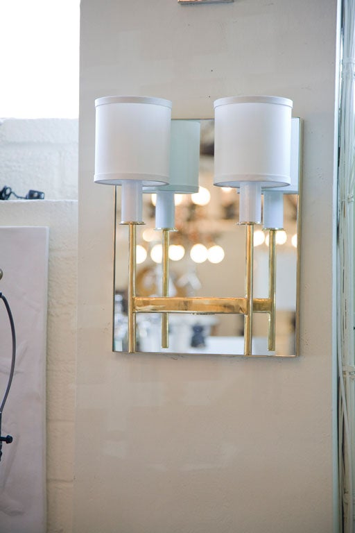 Brass two-arm mirror back sconce by Paul Marra. Also available to order as one-arm. Price quoted is per each. By order only.