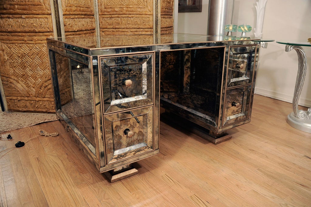 Mirrored Chinoiserie partners desk. Features four drawers on each side and shell pulls.<br />