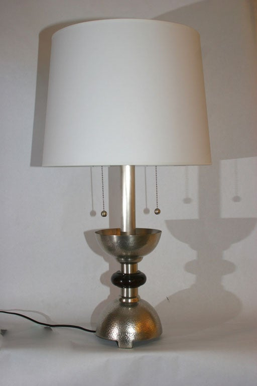 A pair of modernist table lamps silver plated and wood  New sockets and rewired Shades not included