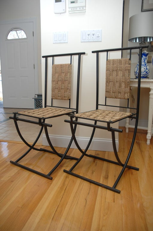 Set of four Mid-Century Moroccan folding chairs.