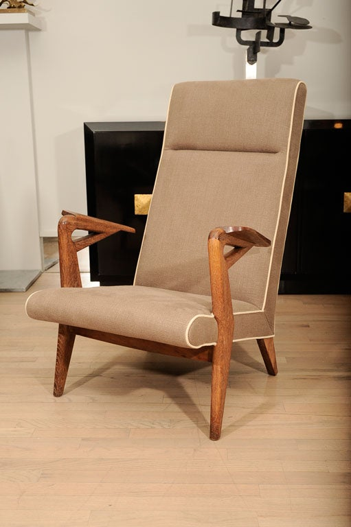 Elegant pair of limed oak armchairs by Parker Knoll.