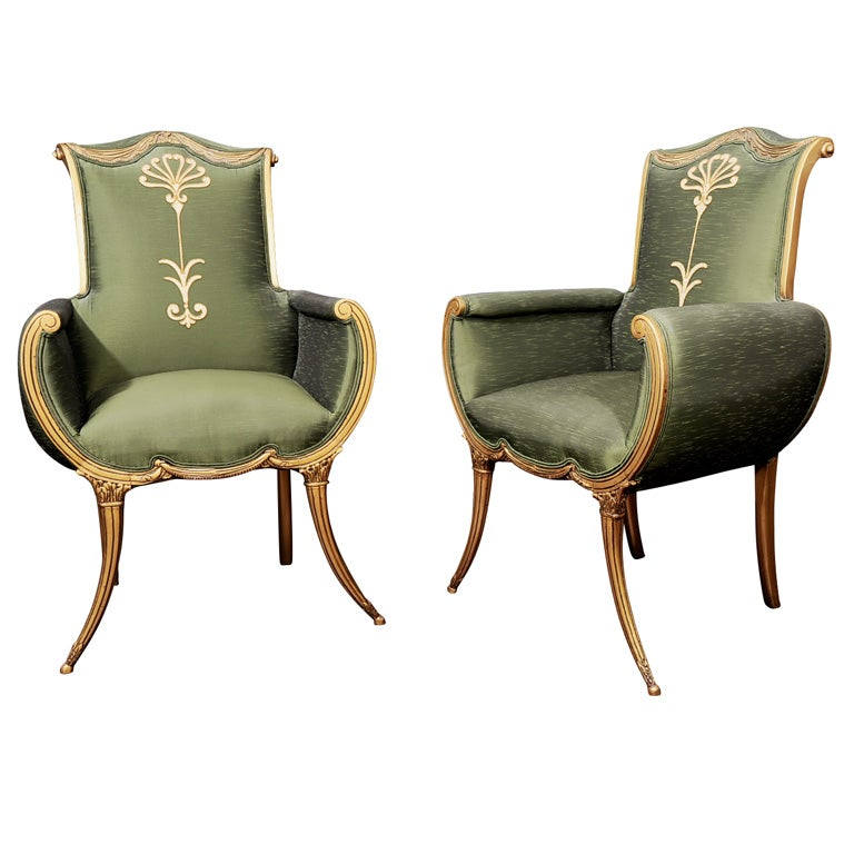 A Most Graceful Pair Of Hollywood Regency Armchairs For