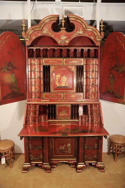 Circa 1900-1920 English Chinoiserie Secretaire/Bureau in scarlet crackle glaze and gilt-japanned decorations, with secret compartments. Decorated overall with elaborate Chinoiserie figures and foliage, the triple dome molded cornice is decorated