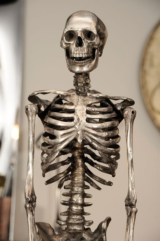This remarkable skeleton is a 1940s handmade silvered bronze anatomic model made in America. We have added the custom stand.