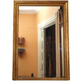 Antique French Louis XVI gold leaf mirror.