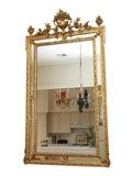 Antique French Louis XVI gold leaf cushion mirror.